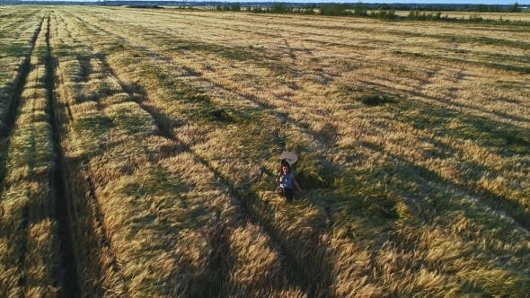 Thumbnail for Happy Woman Walking with a Guitar at Wheat Field