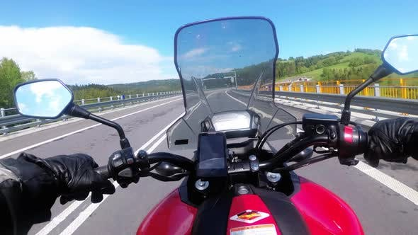 Thumbnail for Motorcyclist Riding on Empty Highway. View From Behind the Wheel of a Motorbike. POV