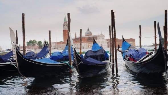 Thumbnail for Gondolas on the Pier. Against the Cityscape of Venice