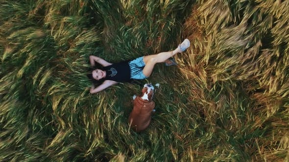 Thumbnail for Girl with Her Dog Is Resting in the Field