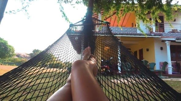 Thumbnail for Girl Relaxing Lying in Hammock in Summer Garden