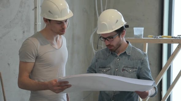 Thumbnail for Two Workers Builders Communicate, Speak of Repairing New House