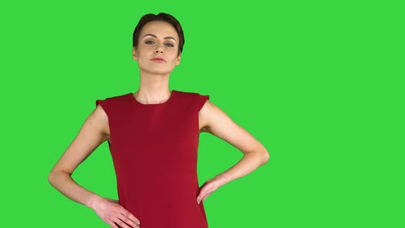 Thumbnail for Beautiful Young Woman with Short Hair in Red Dress Posing on a Green Screen, Chroma Key