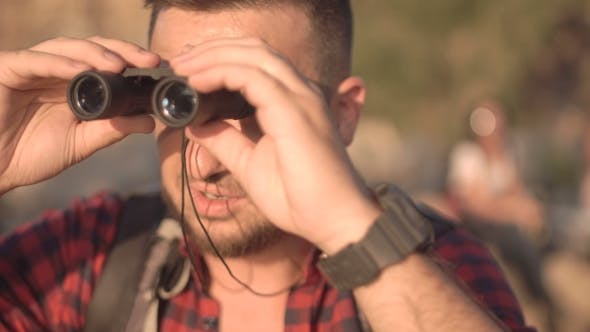 Cover Image for Man with Watching Through Binocular