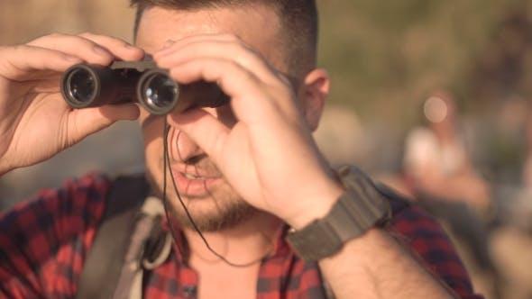 Thumbnail for Man with Watching Through Binocular