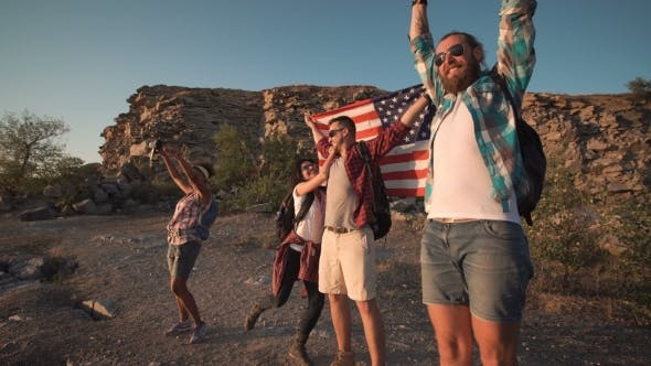 Thumbnail for Excited Travelers Posing with Flag