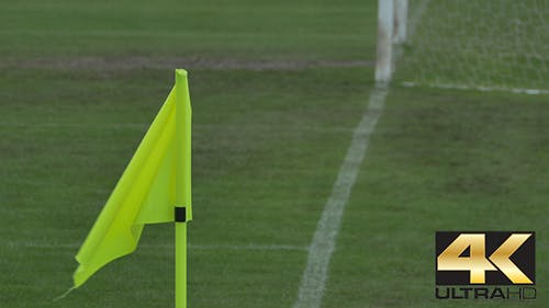 Waving Corner Flag on Pitch