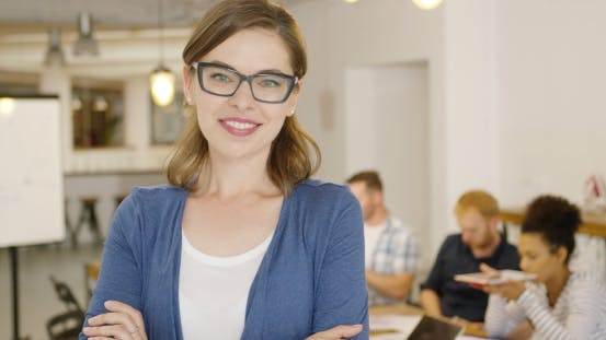 Thumbnail for Young Female Worker Posing in Office