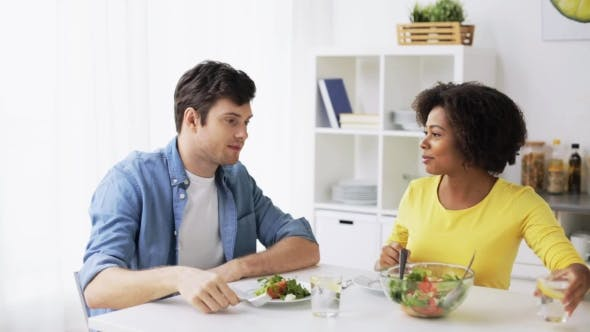 Thumbnail for Happy Couple Eating Vegetable Salad at Home 22