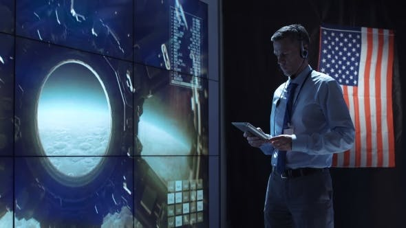 Cover Image for Man with Tablet in Mission Control Center