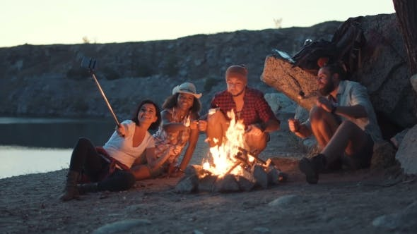 Thumbnail for Friends Near Fireplace on the Coast