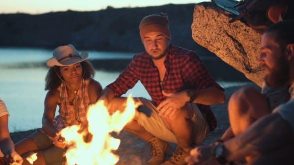 Thumbnail for Friends Having Fun at Campfire
