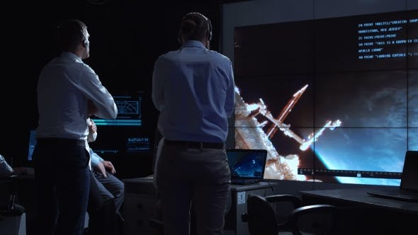 Thumbnail for People Working in Mission Control Center