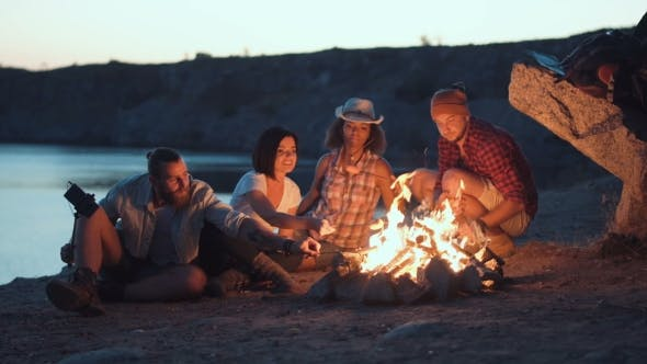 Thumbnail for Cheerful Friends Relaxing Around Campfire