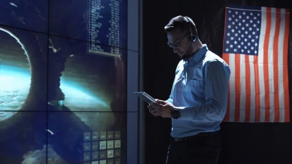Thumbnail for Man with Tablet in Mission Control Center. Elements of This Image Furnished By NASA.