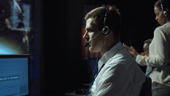 Thumbnail for Man in Headset in Flight Control Center