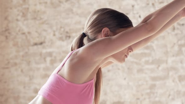 Cover Image for Shooting Exercises Yoga . Sporty Girl Doing Exercises on Mate. Magnificent Stretching and Stability