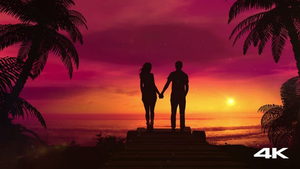 Romantic Couple Watching The Red Sunset In The Ocean