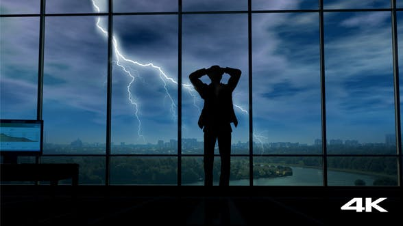 Thumbnail for A Businessman Holds His Head When Thunder Clouds Gather Around Him