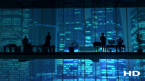 Thumbnail for Silhouettes In An Office Building Against Of Skyscrapers