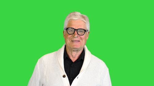 Senior Man Standing and Smiling on Camera on a Green Screen Chroma Key