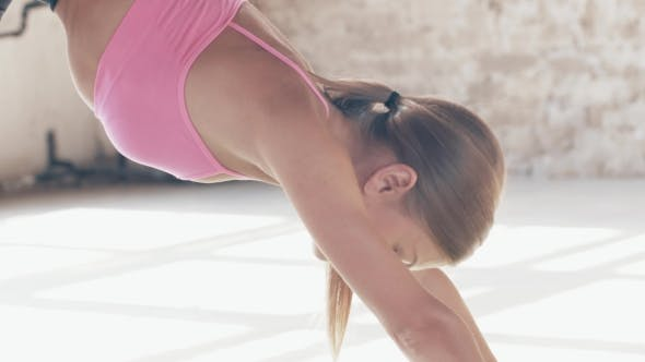 Shooting Exercises Yoga . Sporty Girl Doing Exercises on Mate. Magnificent Stretching and Stability