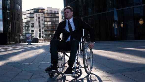 Thumbnail for Physically Disabled Businessman. He Turning His Wheelchair To Camera Front