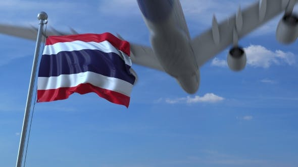 Cover Image for Commercial Airplane Landing Behind Waving Thai Flag
