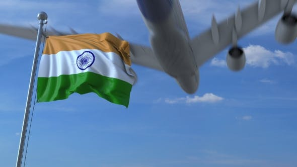 Thumbnail for Commercial Airplane Landing Behind Waving Indian Flag