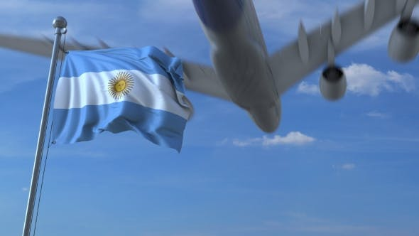 Thumbnail for Commercial Airplane Landing Behind Waving Argentinian Flag