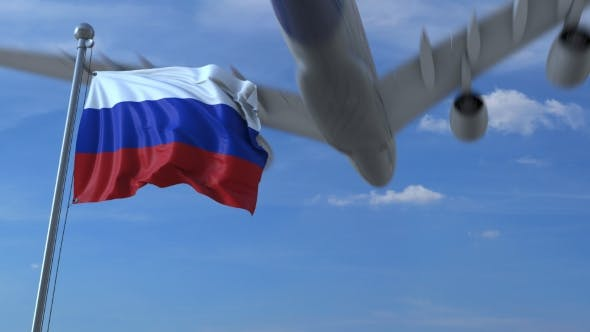 Thumbnail for Commercial Airplane Landing Behind Waving Russian Flag