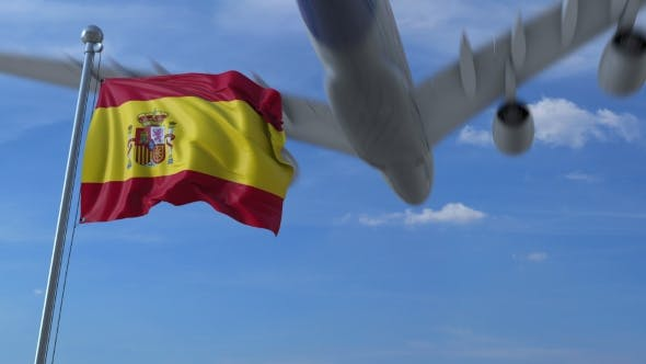 Thumbnail for Commercial Airplane Landing Behind Waving Spanish Flag