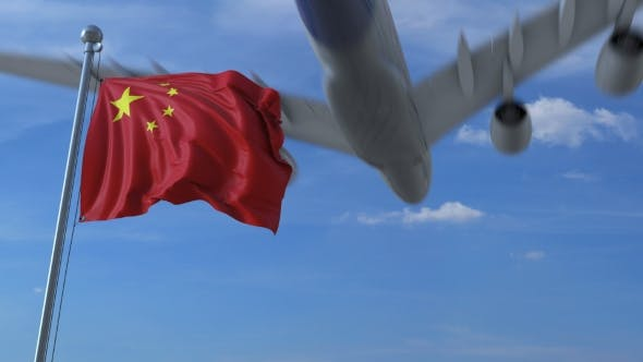 Thumbnail for Commercial Airplane Landing Behind Waving Chinese Flag