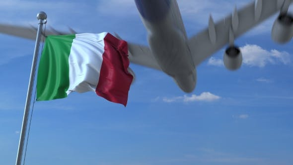 Thumbnail for Commercial Airplane Landing Behind Waving Italian Flag