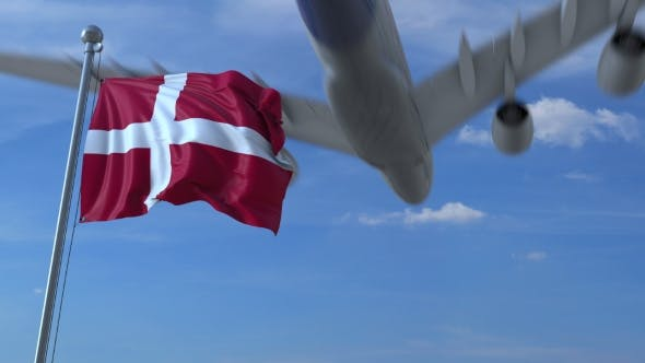 Thumbnail for Commercial Airplane Landing Behind Waving Danish Flag