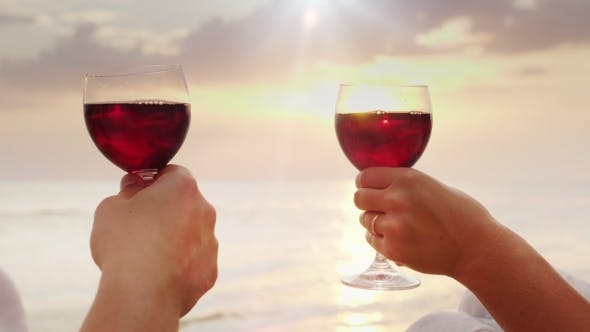 Cover Image for The Hands of Men and Women Hold Glasses with Wine