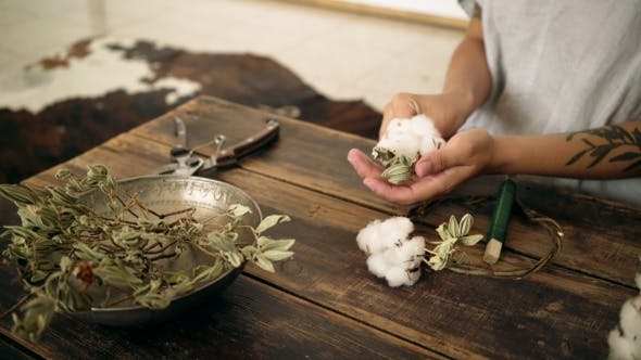 Thumbnail for of Female Hands Work on Cotton Wreath