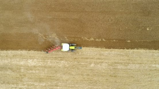 Thumbnail for Agricultural Tractor Plowing Field - Aerial View