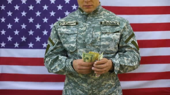 Military Officer Counting Dollar Banknotes, Retirement Payment Serviceman Salary