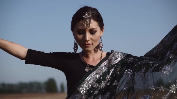 Thumbnail for Gorgeous Indian Woman Dancing in Sari