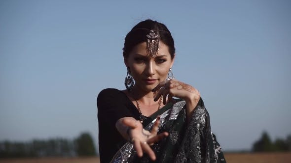Thumbnail for Beautiful Indian Woman Becking and Dancing in Sari