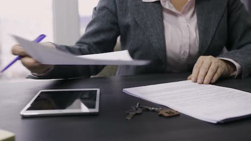 Midsection of Female Saleswoman Working at Table