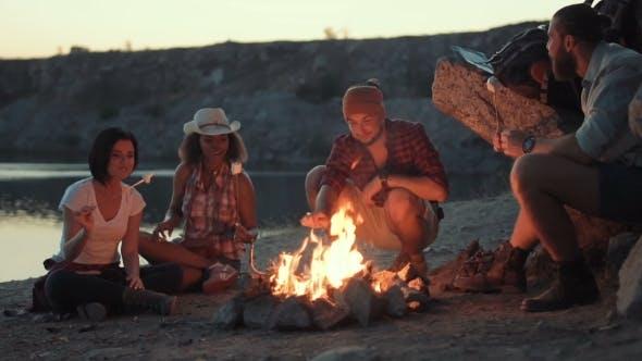 Thumbnail for Traveler Relaxing at Bonfire on Shore