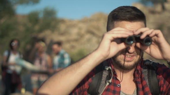 Thumbnail for Man Watching Through Binocular
