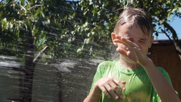 Thumbnail for Kid Being Poured with Water in Garden