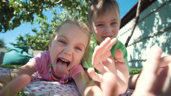 Thumbnail for Grimacing Kids Posing on Lawn
