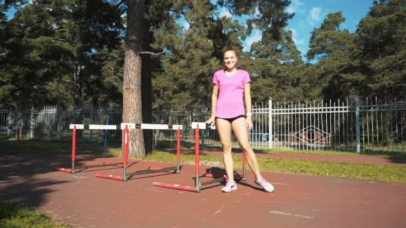 Thumbnail for Professional Female Hurdler in Action. Running with Obstacles, Training