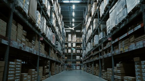 Steadycam Shot of Big Warehouse with Many Goods for Building or Repair Shopping Mall or Stock with