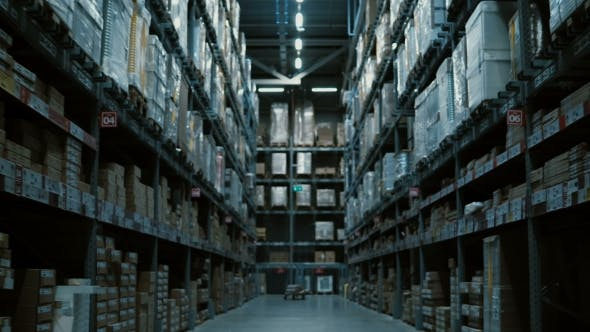 Thumbnail for Camera Moving Between Pallets, Shelves with Some Goods and Materials for Repair at Warehouse Without