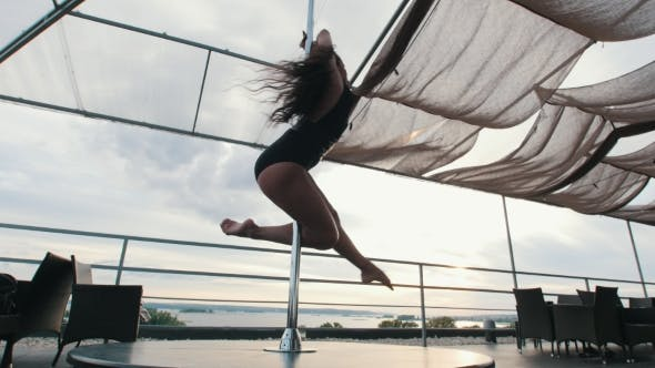 Thumbnail for Young Beautiful Girl Dancer with Flowing Hair Rotated Around Pole - Dance Outdoor